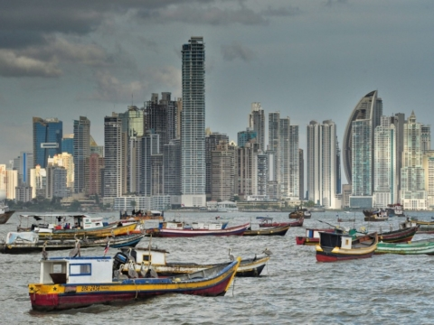 Panama city skyline and fishing boats stationed in the bay