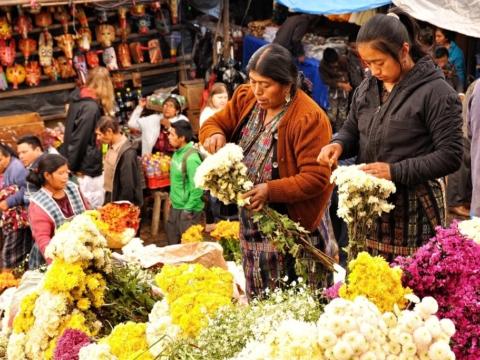 Flower vendors at Chichicastenango market in Guatemala