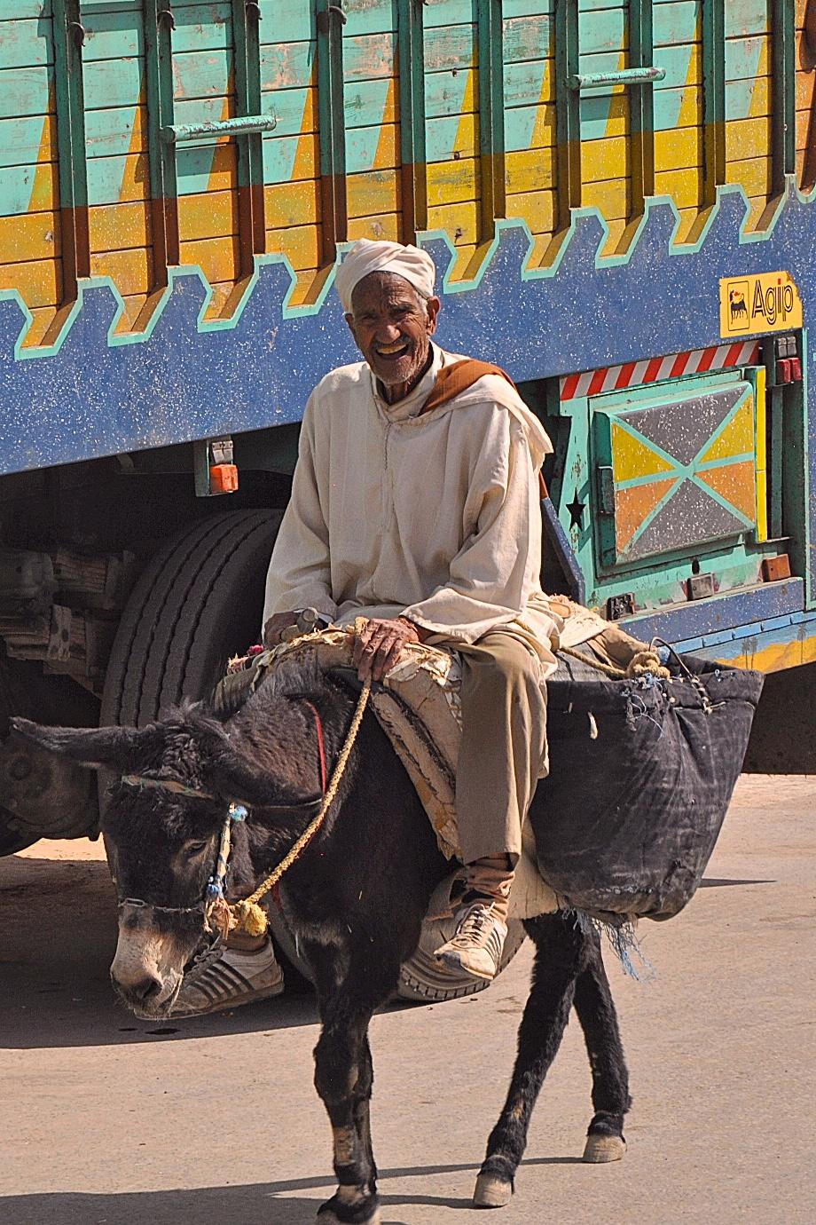 Moroccan elderly man on a donkey